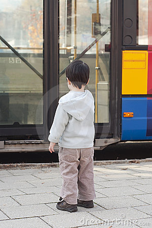 Child at bus stop