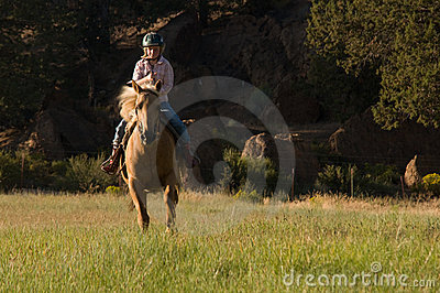 Child Cantering on Palomino