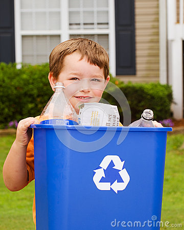Free Child Carrying Recycling Bin Royalty Free Stock Photography - 25273207