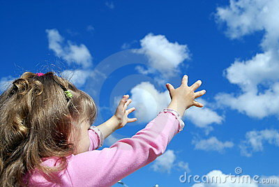 The child catches a cloud two hands