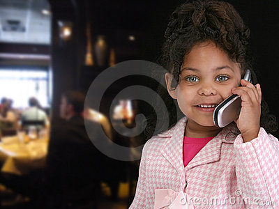 Child on Cellphone in Restaurant