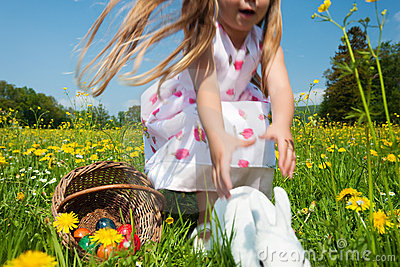Child chasing  Easter bunny