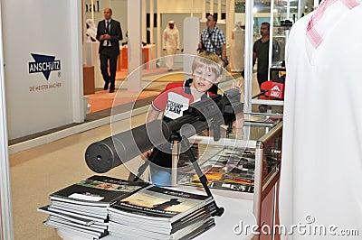 Child checking Gun at Abu Dhabi International Hunting and Equestrian Exhibition 2013 Editorial Photography