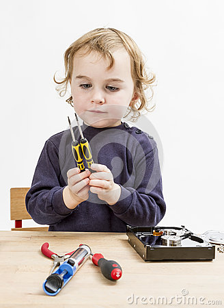 Child choosing tool for repairing hard drive