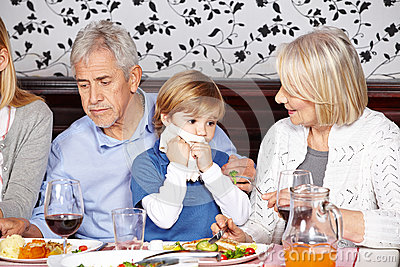 Child cleaning mouth with napkin