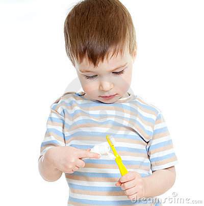 Child cleaning teeth isolated on white background