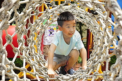 A child climbing a jungle gym.