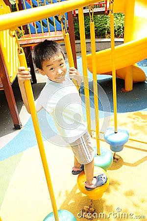 A child climbing a jungle gym.