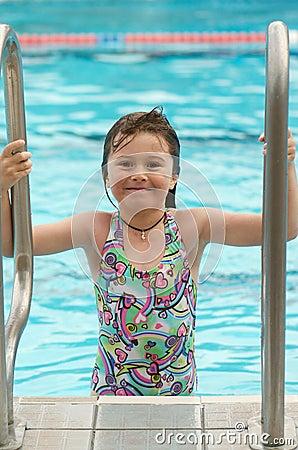 Child climbing pool ladder