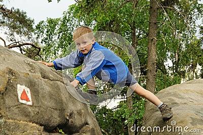 Child climbing rock