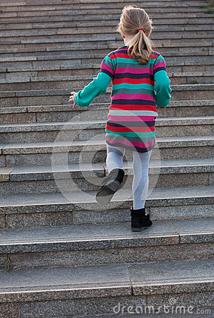 A child is climbing up stairs stock photo image 54687427 for Chaise qui monte les escaliers