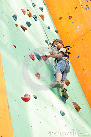 Free Child Climbing Up The Wall Stock Photo - 32613680