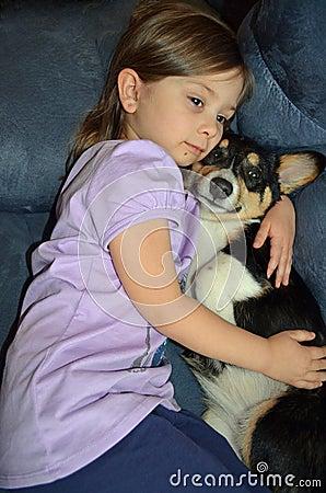 Child and a Corgi