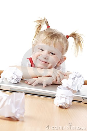 Child with crampled sheets of paper