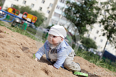Child creeping in sandbox