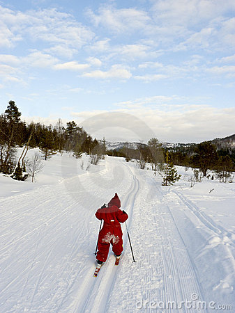 Child cross country skiing
