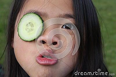 Child and cucumber