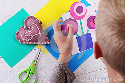 Child cut out of colored paper kid making birthday card - Colored paper art projects ...
