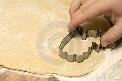 Child cutting out cookies