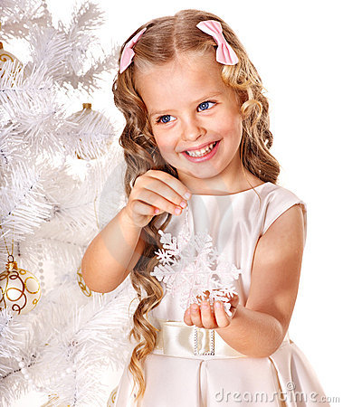 Child decorate Christmas tree.
