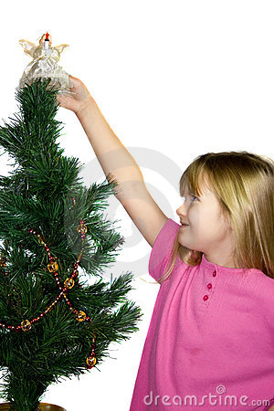 Child decorating Christmas tree.