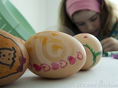 Child decorating Easter eggs