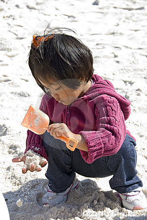 child digging for treasure
