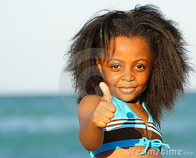 Child Displaying Thumbs Up