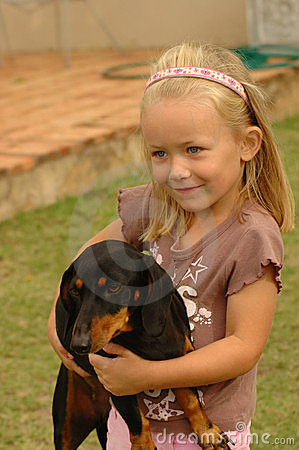 Child with dog pet