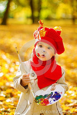 Free Child Drawing On Easel In Autumn Park. Creative Kids Development Royalty Free Stock Images - 33405299