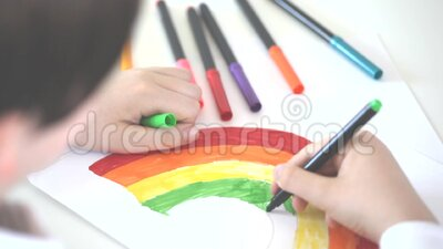 Child drawing a rainbow stock video footage