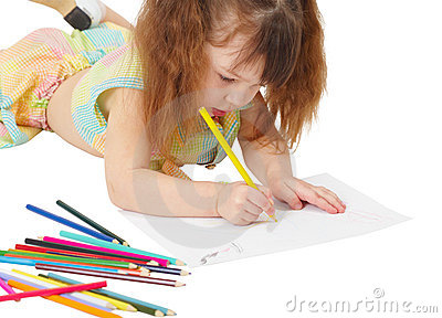 Child draws a picture with colored pencils