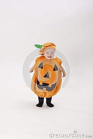 Child dressed as a pumpkin on Halloween