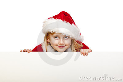 Child dressed as santa claus holds blank ad sign