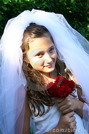 Child dressing up as bride