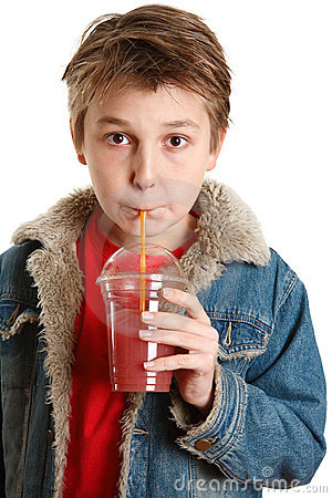 Child drinking fresh fruit juice through a straw