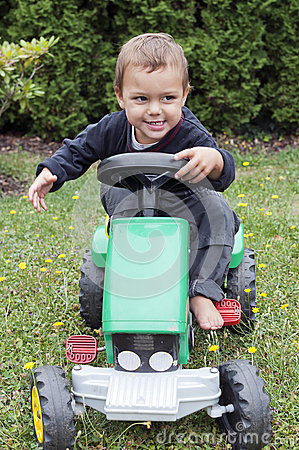 Free Child Driving Toy Tractor Stock Image - 33172811