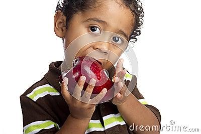 Child Eating Apple Stock Photo