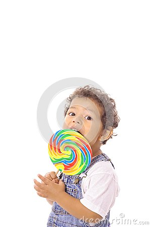 Child eating a big lollipop