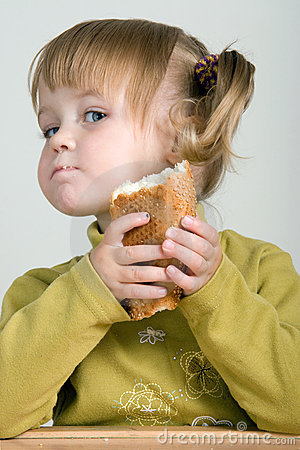 Free Child Eating Bread Royalty Free Stock Photos - 1370878