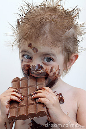 Child eating chocolate