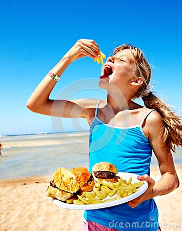 Free Child Eating Fast Food. Royalty Free Stock Photography - 30465327