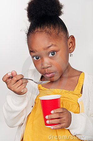 Child Eating Healthy Yogurt