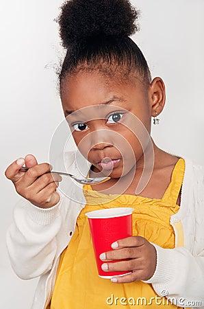 Child Eating Healthy Yogurt