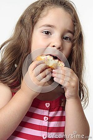 Child eating junk food donut.