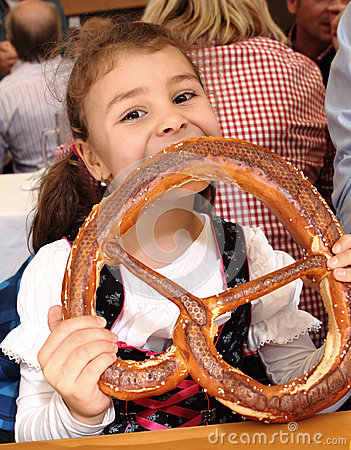 Free Child Eating Pretzel At Oktoberfest, Munich, Germany Stock Photos - 45010483