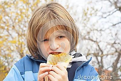 Child eating sandwich