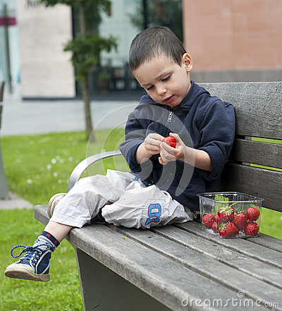 Child eating strawberries