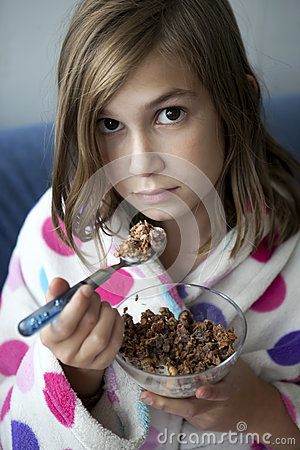 child eating sweet homemade  granola