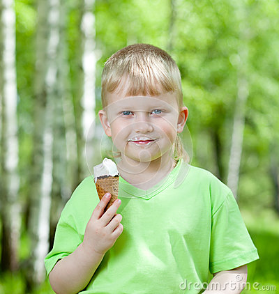 Child eating a tasty ice cream outdoors